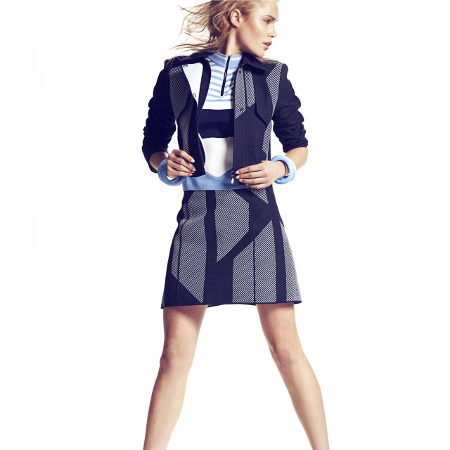 Jacket & skirt by Hugo Boss Top by Topshop Unqiue Shoes by Dr. Martens Cuffs by Tuleste